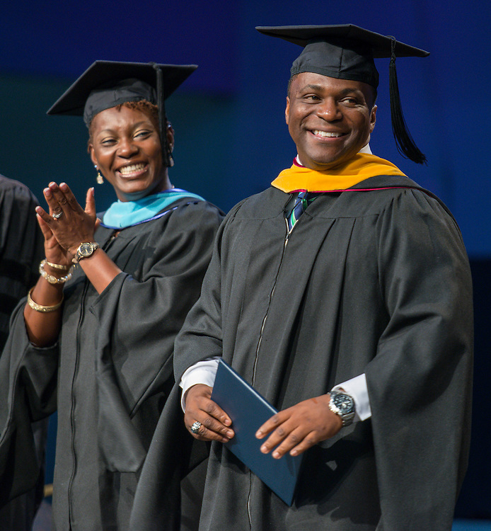 Dameion Crook smiles during the first ever graduation for Mickey Leland College Preparatory Academy, May 27, 2015.