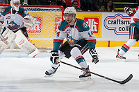 KELOWNA, CANADA - APRIL 25: Rourke Chartier #14 of the Kelowna Rockets blocks a pass against the Portland Winterhawks on April 25, 2014 during Game 5 of the third round of WHL Playoffs at Prospera Place in Kelowna, British Columbia, Canada. The Portland Winterhawks won 7 - 3 and took the Western Conference Championship for the fourth year in a row earning them a place in the WHL final.  (Photo by Marissa Baecker/Getty Images)  *** Local Caption *** Rourke Chartier;