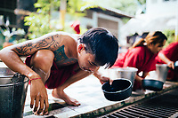 Drug addicts in the rehab program during the ritual drinking and vomiting session at Tham Krabok temple in Saraburi, Thailand.