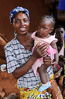 A woman and child at a Positive Living Club supported by PEPAIDS, Ngwezi 'B' Zone, Monze, Zambia. PEPAIDS is a UK-based NGO whose mission is to promote and preserve the health of people in Zambia through the provision of support for HIV/AIDS initiatives and the promotion of awareness of issues surrounding HIV/AIDS. PEPAIDS' local partner NGO is SAPEP, based in the Monze and Mazabuka districts of the Southern Province of Zambia. They work together to empower the rural youth of Zambia to mobilise their communities to fight poverty and HIV/AIDS. SAPEP works with a large number of AIDS Action clubs (AACs) who are trained by SAPEP project staff in subjects such as peer education approaches; gender, customs and traditions; antiretroviral therapy; and counselling. This training empowers the AACs to support the communities in which they are based in the fight against HIV and AIDS. SAPEP encourages AACs to start income generating activities with the goal of being self-reliant and self-sufficient in their mission to alleviate HIV and AIDS. PEPAIDS has designed its training programme to form a cascade in order to reach as many people as possible. Peer educators participate in Training of Trainers workshops, with skills being passed on to club leaders and club members in turn to benefit the wider community. The entire programme is designed to be sustainable, youth-focused, participatory and culturally acceptable.