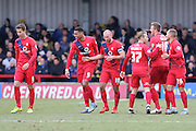York City  congratulate Russell Penn of York City FC after his goal made it 0-1 during the Sky Bet League 2 match between AFC Wimbledon and York City at the Cherry Red Records Stadium, Kingston, England on 19 March 2016. Photo by Stuart Butcher.