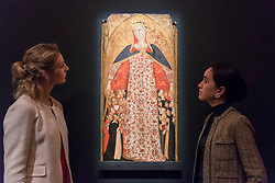 """© Licensed to London News Pictures. 01/12/2017. London, UK.  """"Madonna of Mercy (Madonna della Misericordia)"""", 1340-50, by The Master of 1336, (Est.  GBP400-600k).  Preview of """"Masters of Light"""", Sotheby's Old Masters Evening Sale which will take place on 6 December at Sotheby's, New Bond Street. Photo credit: Stephen Chung/LNP"""