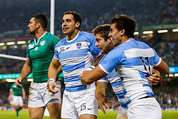 Argentina Winger Juan Imhoff celebrates with Full Back Joaquin Tuculet and Fly-Half Nicolas Sanchez after scoring the second try of the game - Mandatory byline: Rogan Thomson/JMP - 07966 386802 - 18/10/2015 - RUGBY UNION - Millennium Stadium - Cardiff, Wales - Ireland v Argentina - Rugby World Cup 2015 Quarter Finals.