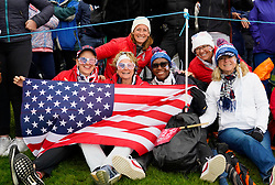 Auchterarder, Scotland, UK. 14 September 2019. Saturday afternoon Fourballs matches  at 2019 Solheim Cup on Centenary Course at Gleneagles. Pictured; Team USA fans sitting beside the 8th green. Iain Masterton/Alamy Live News