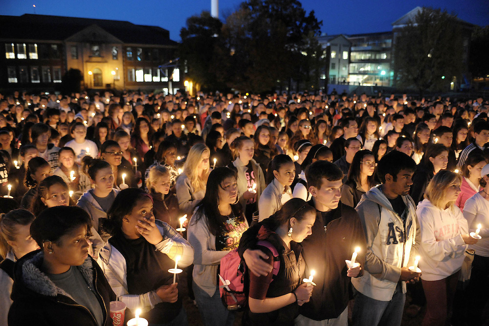 Students gather for a candle vigil for Connecticut football player Jasper Howard in Storrs, Conn., Wednesday, Oct. 21, 2009. Twenty-year-old Howard, of Miami, a junior and starting cornerback, and a second person were stabbed during a fight early Sunday after someone pulled a fire alarm during a dance at the UConn Student Union, police said.