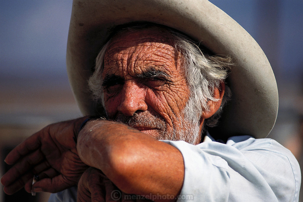 Gene Churchill, rancher near Lone Pine Station, California (He was raising his two young sons alone since his wife was arrested 18 months earlier for drugs and prostitution. Route 395: Eastern Sierra Nevada Mountains of California.  MODEL RELEASED.