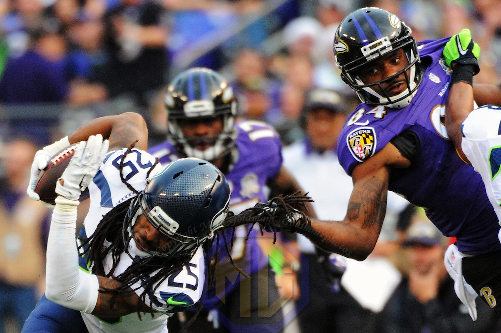 13 December 2015:   Seattle Seahawks cornerback Richard Sherman (25) intercepts a pass intended for receiver Chris Matthews (84) at M&T Bank Stadium, in Baltimore, MD. where the Seattle Seahawks defeated the Baltimore Ravens, 35-6.  (Photograph by Mark Goldman/Icon Sportswire)