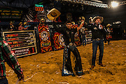 Cuiabanno Lima, right raise the arms of a winning cowboy at a rodeo  in Goiania, Brazil, Friday, Dec. 16, 2016. Considered one of the economic pillars of Brazil, hoarding increasingly huge swaths of land and spreading the same amounts of environmental degradation and land conflicts, the powerful agribusiness finds its heart, soul and voice in the city of Goiânia. Home of a million and a half souls it sits on the immense central plains of Brazil and nurtures a rodeo culture and cowboy lifestyle challenging its own urbanization, highlighting the archaic and rural character of Brazilian mindset and its society. (Dado Galdieri for the New York Times)