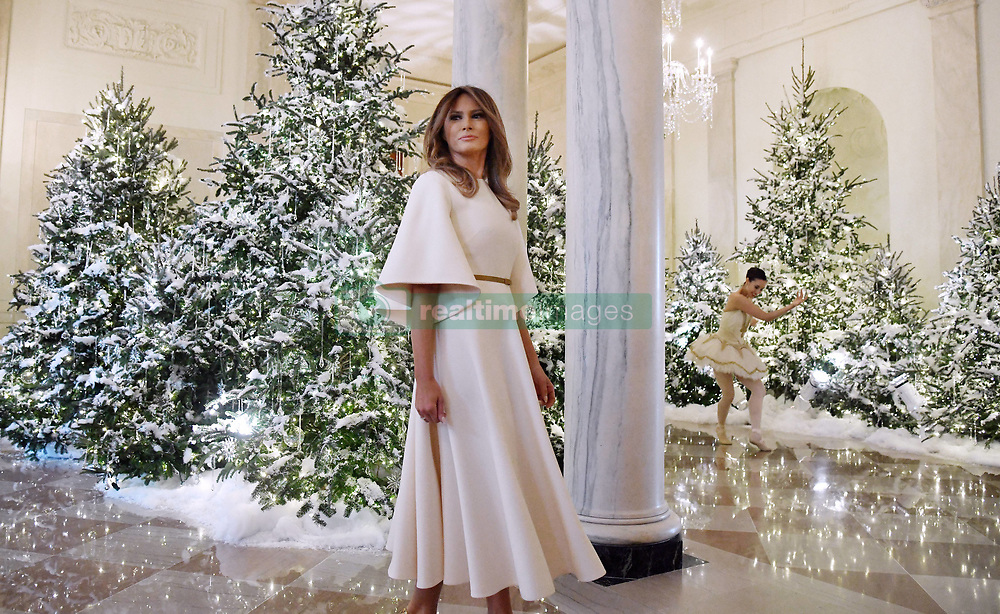 First Lady Melania Trump participates in arts and crafts projects with children and students from Joint Base Andrews in the East Wing of the White House in Washington, DC, November 27, 2017. Credit: Olivier Douliery / Pool via CNP. 27 Nov 2017 Pictured: First Lady Melania Trump looks at a performance in the Grand Foyer of the White House in Washington, DC, as she also participates in arts and crafts projects with children and students from Joint Base Andrews on November 27, 2017. Credit: Olivier Douliery / Pool via CNP. Photo credit: Olivier Douliery - Pool via CNP / MEGA TheMegaAgency.com +1 888 505 6342