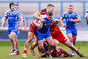 Halifax RLFC loose forward Jacob Fairbank (13) is stopped  during the Betfred Championship match between Halifax RLFC and London Broncos at the MBi Shay Stadium, Halifax, United Kingdom on 8 April 2018. Picture by Simon Davies.