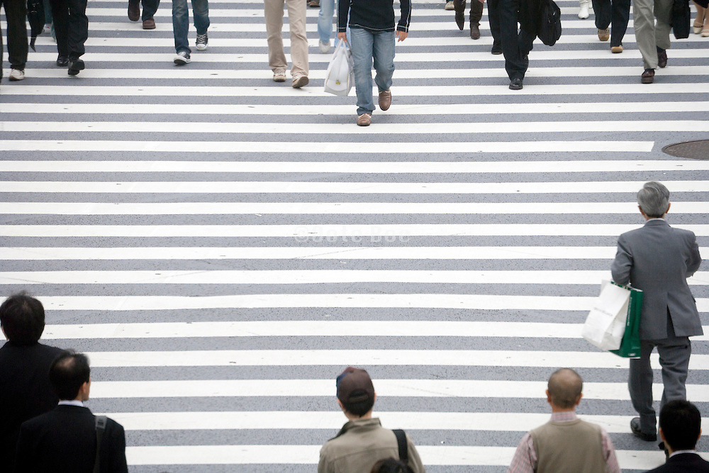 people crossing the Hachiko square zebra crossing at Shibuya station in Tokyo Japan
