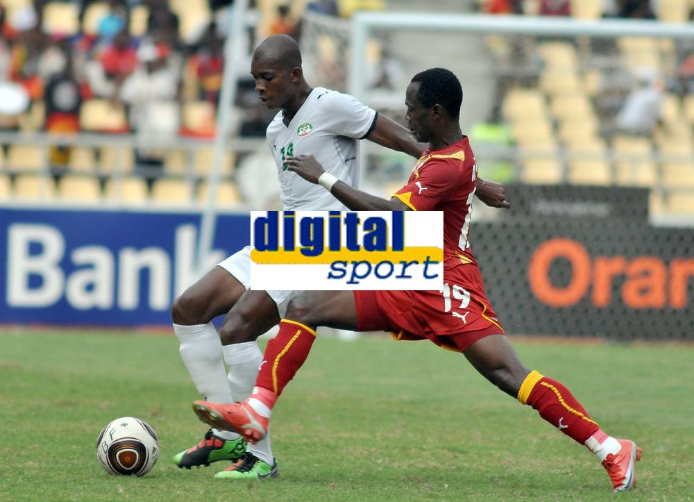 FOOTBALL - AFRICAN NATIONS CUP 2010 - GROUP B - BURKINA FASO v GHANA - 19/01/2010 - PHOTO MOHAMED KADRI / DPPI - CHARLES KABORE (BUR) / EMMANUEL AGYEMANG BADU (GHA)