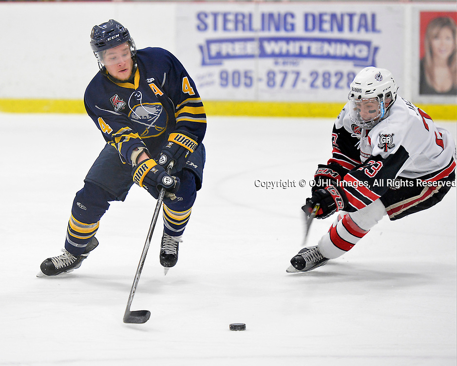 GEORGETOWN, ON  - MAR 11,  2017: Ontario Junior Hockey League, playoff game between the Georgetown Raiders and Buffalo Jr. Sabres.  Aaron Reinig #4 of the Buffalo Jr. Sabres tries to keep the puck from Jack Jacome #23 of the Georgetown Raiders during the second period.  <br /> (Photo by Shawn Muir / OJHL Images)