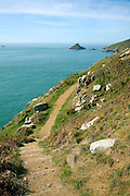 Coastal footpath south east Island of Herm, Channel Islands, Great Britain looking south to small islet of Grande Faunconniere.