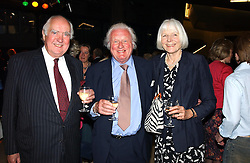Left to right, PETER BOIZOT and VISCOUNT & VISCOUNTESS NORWICH at a concert performance of Death in Venice by Benjamin Britten in aid of The Venice in Peril Fund held at the Queen Elizabeth Hall, London on 30th June 2004.  Before the concert a cheque for 1 Million Pounds was presented by Pizza Express to the The Venice in Peril Fund.