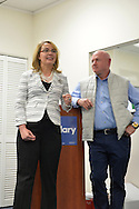 Garden City, New York, USA. April 17, 2016. GABBY GIFFORDS, former United States Congresswoman, is speaking, with her husband MARK KELLY, former NASA astronaut, standing nearby, about the importance of GOTV, Getting Out The Vote for Hillary Clinton - including because of Clinton's strong position on stricter gun control legislation - at the Canvass Kickoff at the Nassau County Democratic Office in Garden City. After Kelly then Giffords spoke, they posed for photos with volunteers who attended the campaign Official Event. Giffords survived an assassination attempt near Tuscon, Arizona, during her first 'Congress on Your Corner' event in January 2011. Kelly commanded the final flight of the Space Shuttle Endeavor in May 2011.