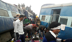 November 20, 2016 - Allahabad, Uttar Pradesh, India - Rescue workers after more than 100 people were killed after 14 carriages of an Indian express train derailed in northern Uttar Pradesh state (Credit Image: © Prabhat Kumar Verma/Pacific Press via ZUMA Wire)