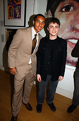 Left to right, footballer THEO WALCOTT and actor DANIEL RADCLIFFE  at the opening of an exhibition entitled Exceptional Youth supported by Teen Vogue at the National Portrait Gallery, London on 3rd November 2006.<br /><br />NON EXCLUSIVE - WORLD RIGHTS