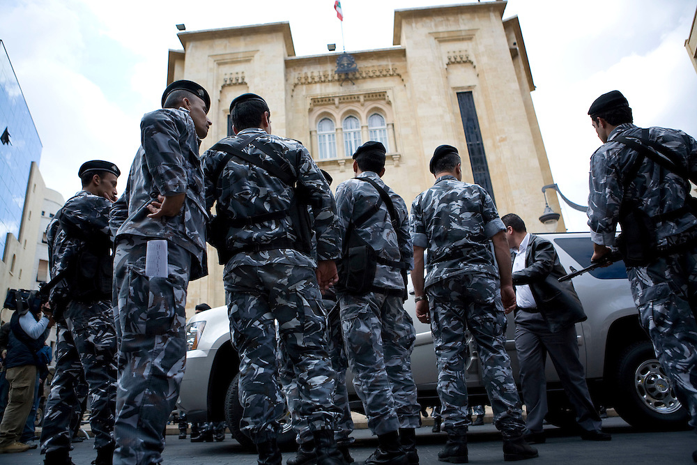 Lebanese policemen standing guard outside the parliament as legislators decide to postpone the presidential elections until November 30.