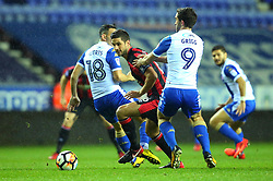 Andrew Surman of Bournemouth takes on Will Grigg of Wigan Athletic - Mandatory by-line: Robbie Stephenson/JMP - 17/01/2018 - FOOTBALL - DW Stadium - Wigan, England - Wigan Athletic v Bournemouth - Emirates FA Cup third round proper