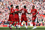 Liverpool forward Sadio Mane (10) celebrates his second goal 2-1 with Liverpool forward Roberto Firmino (9) Liverpool forward Mohamed Salah (11)\ and Liverpool midfielder Georginio Wijnaldum (5) during the Premier League match between Liverpool and Newcastle United at Anfield, Liverpool, England on 14 September 2019.