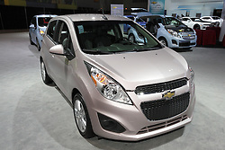 08  February 2013: 2014 Chevrolet Spark EV automobile. Chicago Auto Show, Chicago Automobile Trade Association (CATA), McCormick Place, Chicago Illinois<br /> <br /> 2013 CHEVROLET SPARK: Chevrolet's first mini car for North America, the 2013 Spark, is a fashionable five-door hatchback with the look of a sporty three-door. Spark is geared towards first-time buyers and urban residents. With bold styling, affordability, safety features, fuel efficiency and maneuverability, the Spark comes powered by a fuel-sipping 1.2-liter four-cylinder that delivers 84 horses. The dual-overhead cam engine is mated to a standard five-speed manual gearbox or optional four-speed automatic transmission. Though compact, Spark offers a comfortable four-passenger cabin, or when rear seating is down, an impressive 31.2 cu. ft. of cargo room. Spark offers OnStar safety and security system, as well as exclusive MyLink infotainment system, which features the personalized connectivity of Pandora and Stitcher internet radio. Styling enhancements for 2013 include a fresh grille and front fascia, a longer rear fascia, and modified head and taillights. Spark's wheels-at-the-corners stance is further emphasized by standard 15-inch alloy wheels and all-season tires. Take note of how the designers cleverly disguised the rear doors by integrating the handles into the C-pillar area. Attention-grabbing exterior finishes include Salsa Red, Jalapeno, Denim, Lemonade and Techno Pink, as well traditional black, silver and white hues.