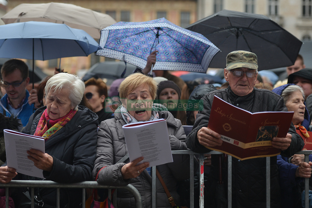 May 3, 2017 - Krakow, Poland - Hundreds of people attend the 64th 'Lesson of Singing' on 'Little Market Square' in Krakow during May 3rd Constitution Day..On Wednesday, May 3, 2017, in Krakow, Poland. (Credit Image: © Artur Widak/NurPhoto via ZUMA Press)
