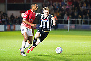 Salford City defender Ibou Touray challenged by the opponent during the EFL Sky Bet League 2 match between Salford City and Grimsby Town FC at Moor Lane, Salford, United Kingdom on 17 September 2019.