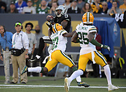 Aug 22, 2019; Winnipeg, Manitoba, CAN; Oakland Raiders wide receiver De'Mornay Pierson-El (9) is defended by Green Bay Packers cornerback Josh Jackson (37)  in the first half at Investors Group Field. The Raiders defeated the Packers 22-21.