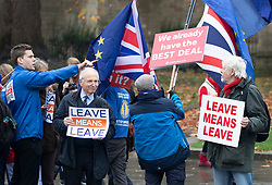 © Licensed to London News Pictures. 05/12/2018. London, UK. London, UK. Pro-Brexit demonstrators surround a Remain campaigner (2nd R) oppostite Parliament. Today the House of Commons debates on the Brexit withdrawal agreement for the second day ahead of the meaningful vote. Photo credit: Peter Macdiarmid/LNP