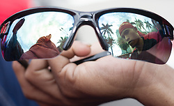 May 1, 2019 - Jakarta, DKI Jakarta, Indonesia - A reflection of a demonstrator with a head ban seen on shades during the commemoration..Workers marched demonstrating while commemorating May Day 2019, they demand for the government to immediately revoke Government Regulation No. 78 of 2015 concerning Wages. (Credit Image: © Nick Hanoatubun/SOPA Images via ZUMA Wire)