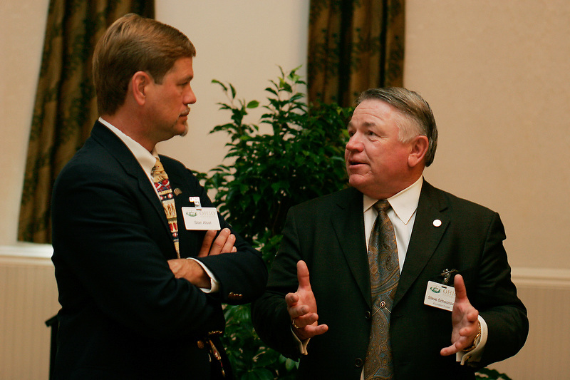 Steve Schoonover, right, and Professor Stan Alost joke with each other during a luncheon on September 12, 2006 at Ohio University in Athens, Ohio.  The event was part of a Scripps School of Communication Day.