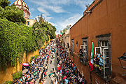 Concheros dance in a procession through the historic district during the week long fiesta of the patron saint Saint Michael September 30, 2017 in San Miguel de Allende, Mexico.