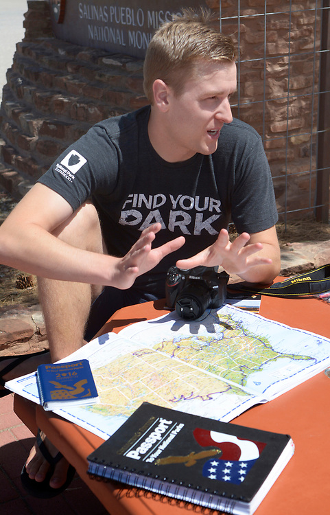 gbs041217a/STATE -- Mikah Meyer of Lincoln, Nebraska is on a quest to visit all of the 415+ U.S. National Park Service sited in one continuous journey. While in Mountainair he shows a U.S. map with his journey so far outlined. (Greg Sorber/Albuquerque Journal)