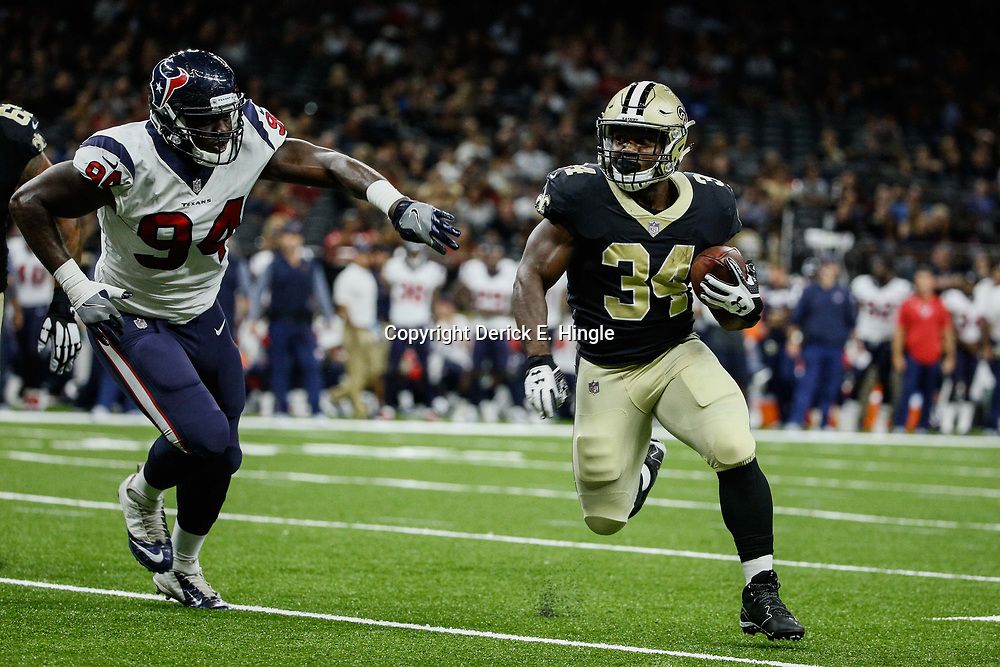 Aug 26, 2017; New Orleans, LA, USA; New Orleans Saints running back Darius Victor (34) runs past Houston Texans defensive end Ufomba Kamalu (94) during the second half of a preseason game at the Mercedes-Benz Superdome. The Saints defeated the Texans 13-0. Mandatory Credit: Derick E. Hingle-USA TODAY Sports
