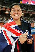 Valerie Adams of New Zealand is celebrates winning Gold in the Women's Shot Put, and a new Commonwealth Games record. Athletics, Shot Put, Day 6, XIX Commonwealth Games, New Delhi, India. Saturday 9th October 2010. Photo: Simon Watts / photosport.co.nz