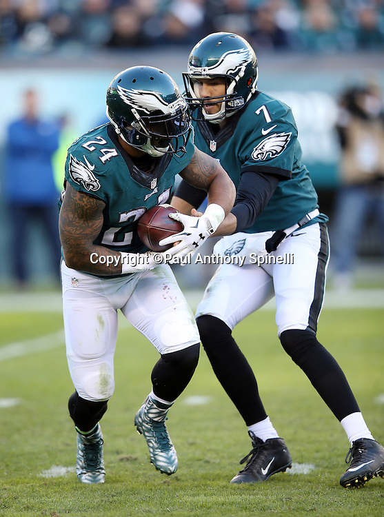 Philadelphia Eagles running back Ryan Mathews (24) takes a handoff from Philadelphia Eagles quarterback Sam Bradford (7) as he runs for a third quarter gain of 12 yards during the 2015 week 10 regular season NFL football game against the Miami Dolphins on Sunday, Nov. 15, 2015 in Philadelphia. The Dolphins won the game 20-19. (©Paul Anthony Spinelli)