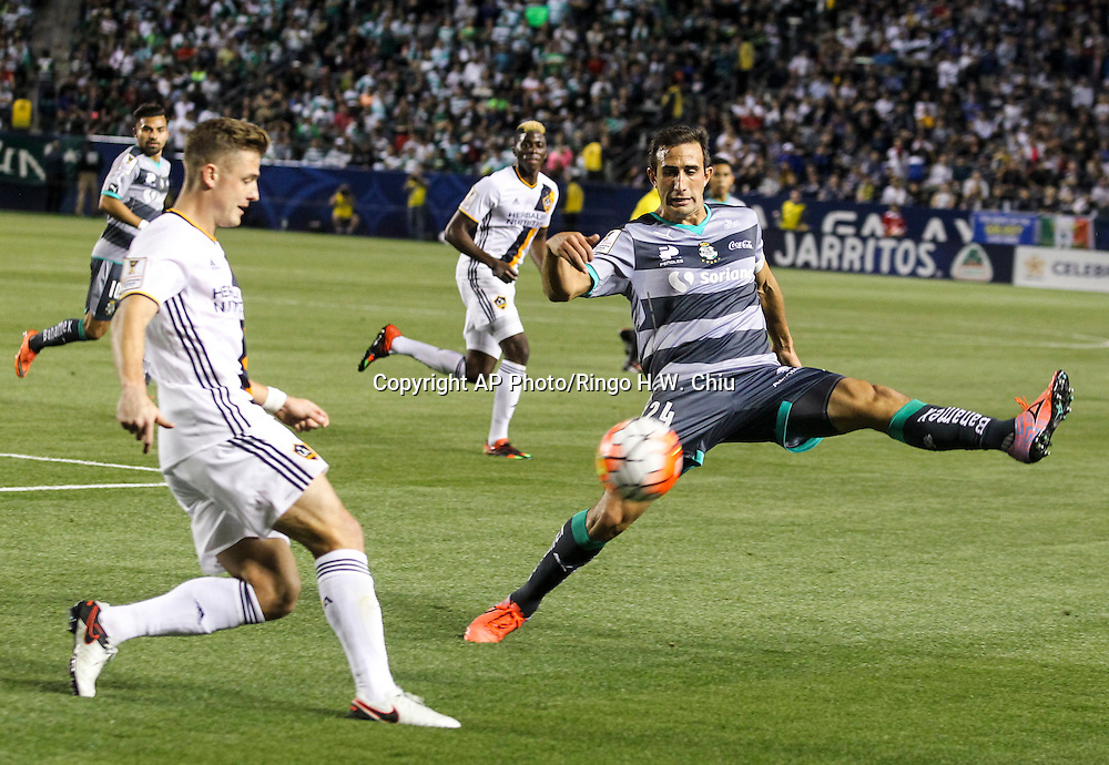 Santos Laguna defender Carlos Izquierdoz, right, and Los Angeles Galaxy midfielder Robbie Rogers battle for  ball during the first half of a CONCACAF Champions League quarterfinal  in Carson, Calif., Wednesday, Feb. 24, 2016. (AP Photo/Ringo H.W. Chiu)