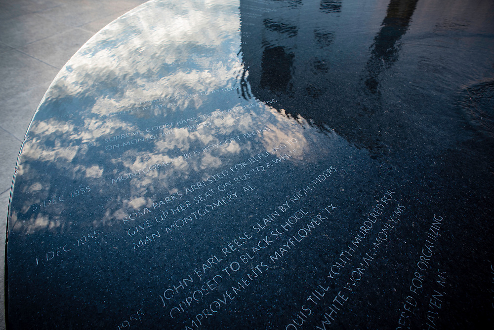 MONTGOMERY, AL -- 5/24/17 -- The sky is reflected in the Civil Rights Memorial commissioned by the Southern Poverty Law Center and dedicated in 1989. The memorial is the cornerstone of the Civil Rights Memorial Center which is housed in the former offices of the SPLC. <br /> Civil Rights attorney Morris Dees co-founded the Southern Poverty Law Center in 1971. The group has taken on the Ku Klux Klan and fought for against hate for decades, but is now facing criticism that it has labeled some groups without just cause..&hellip;by Andr&eacute; Chung #_AC17226
