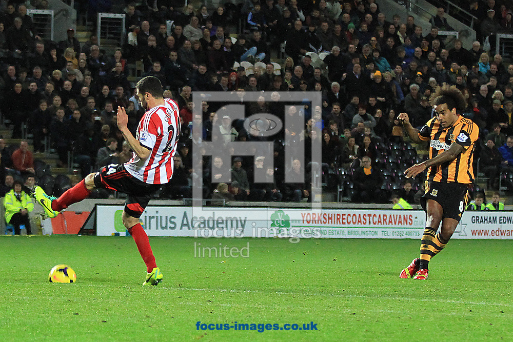 Picture by Richard Gould/Focus Images Ltd +44 7855 403186<br /> 02/11/2013<br /> Tom Huddlestone of Hull City has a shot as Carlos Cu&eacute;llar (left) of Sunderland blocks the shot during the Barclays Premier League match at the KC Stadium, Kingston upon Hull.