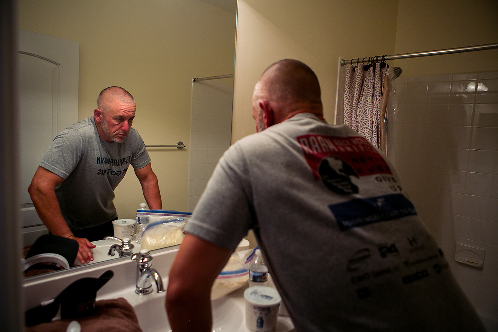 ARLINGTON, VA - OCTOBER 15, 2016:  Jerome Libecki attempts to recover at his friend's house in Arlington, Virginia, after dropping out of the Quintuple Anvil race in Lake Anna State Park in Spotsylvania, Virginia. CREDIT: Sam Hodgson for The New York Times.