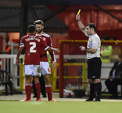 Swindon Town's Jordan Turnbull receives a yellow card from referee Tim Robinson - Photo mandatory by-line: Paul Knight/JMP - Mobile: 07966 386802 - 03/03/2015 - SPORT - Football - Swindon - The County Ground - Swindon Town v Gillingham - Sky Bet League One