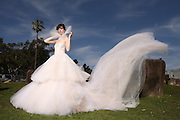 Model, Ashlee Alland wears the Sigourney wedding gown by Vera Wang