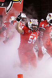 11 December 2015:  Mark Spelman(54) takes the field amidst the smoke in front of the tunnel.  NCAA FCS Quarter Final Football Playoff game between Richmond Spiders and Illinois State Redbirds at Hancock Stadium in Normal IL (Photo by Alan Look)