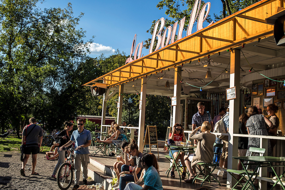 People sit outside La Boule, a cafe in Gorky Park, on Saturday, August 17, 2013 in Moscow, Russia.