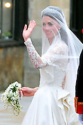 Kate Middleton waves as she arrives at Westminster Abbey for her wedding to Prince William in London on April 29, 2011. The royal wedding will take place before 1,900 guests.  UPI/Kevin Dietsch