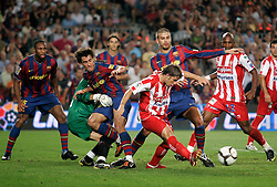Sporting de Gijon's Alberto Rivera (c) and FC Barcelona's Bojan Krkic (l) and Gerard Pique (r) during La Liga match.August 31 2009.