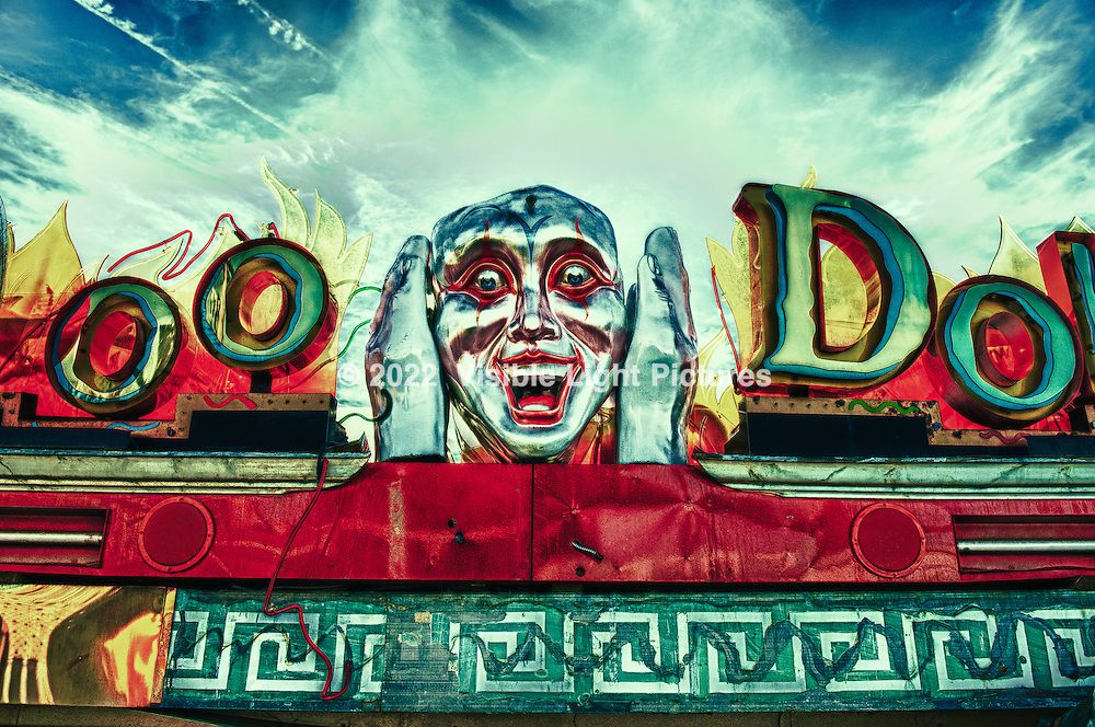 Voo Doo Doll attraction from the Neon Museum in Las Vegas, Nevada, USA.  This photo is an HDR process, shot in the late afternoon, back lit.  Part of a collection of recovered signs and other carnival and amusement park attractions from around the area.