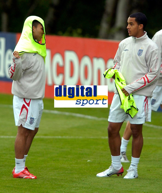 Photo: Richard Lane.<br />England Training Session. 22/05/2006.<br />Aaron Lennon (L) and Theo Walcott have a chat during training.