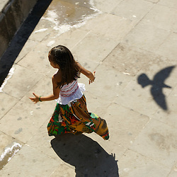 A young mexican girl plays on the malecon in Puerto Vallarta, Mexico.